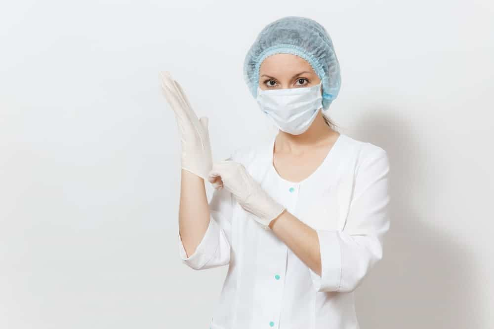 women wearing gloves and a mask
